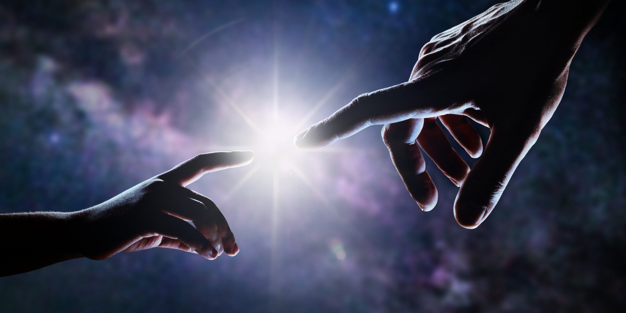 Close up of two hands, adult's and child's, reaching each other like Michelangelo's painting in front of stars and galaxy. Light is shining between father's and son's fingers. High contrast, lens flare.